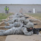 Soldiers of 870th Military Police Company fire their M4 rifles at the range, to meet annual marksmanship qualification requirements.