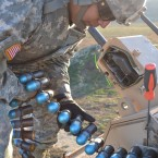 (Camp Roberts, CA) – Private First Class Francisco Romero, of the California Army National Guard's 40th Military Police (MP) Company, prepares to feed a belt of 40-millimeter rounds into a mounted MK-19 automatic grenade launcher, on top of an M1117 Armored Security Vehicle (ASV) during training on February 13, 2013.   (Army National Guard photo/ SPC Danica Cho/ Released)